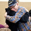 Navy veteran Gale Hikade gets a big hug from his great-grandson, junior Jeron Mason during the Veterans Day breakfast hosted by Madison-Grant Jr.-Sr. High School Athletic Department Monday.