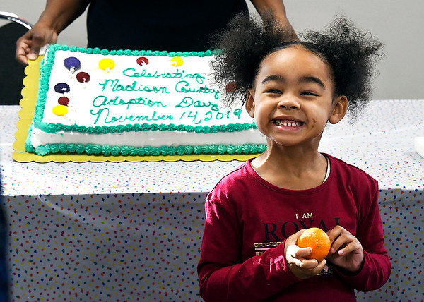 Four year-old Maleigh Murray smiles as she gets her picture taken with the cake celebrating Madison County Adoption Day as part of National Adoption Day. Maleigh was adopted by her grandmother Brenda Murray Thursday.