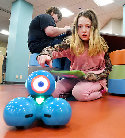 Elizabeth Dearduff, 10, gives Dash a little tap as she tries to control the robot with her tablet during the You Choose program at the Anderson Public Library's Children's Department Wednesday afternoon. The program is designed for students with an interest in gaming and STEAM in which they choose activities of their liking.<br /> <br /> <br /> <br /> You Choose program in the Children's Department of the Anderson Public Library.