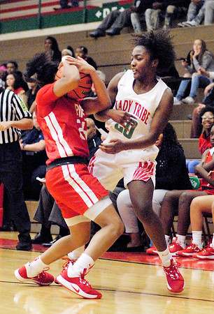 Anderson High School freshman Zoe Allen battles Pike High School's Joslynn Spears for the ball.
