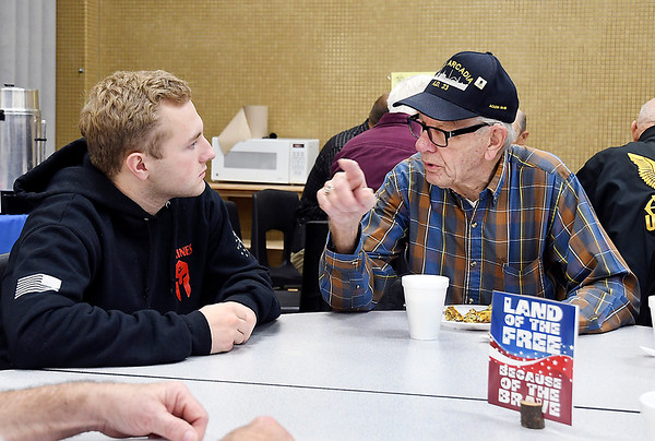 Madison-Grant senior Jacob Harms talks with Navy veteran Gale Hikade during the Veterans Day breakfast hosted by Madison-Grant Jr.-Sr. High School Athletic Department Monday. Harms inlisted into the U.S. Marines next year to study aviation mechanics.