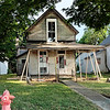 This is a photo of the pink house now that is on West Ninth Street when Perry started rehabbing it.