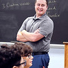 Elwood High School English teacher Shane Arnold has a laugh with his students in his classroom.