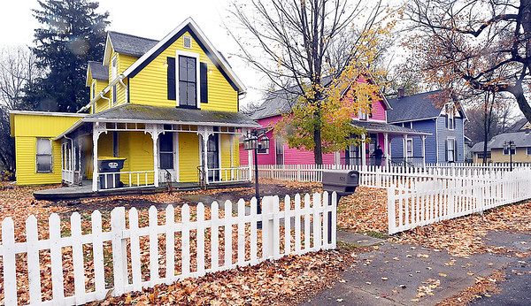 These three houses on West Ninth Street are being rehabbed by Tim Perry of Picket Fence of Anderson, with the center house already being occupied.
