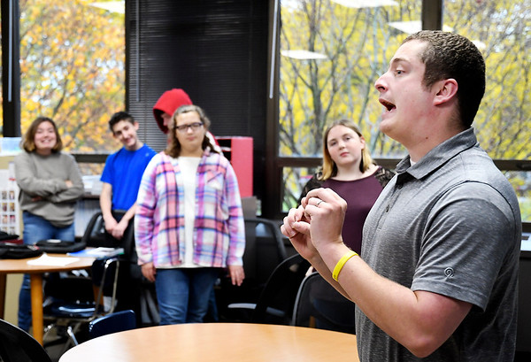 """Elwood High School English teacher Shane Arnold leads his class in a spirited discussion on """"what would you do"""" in different circumstances."""