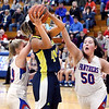 Shenandoah's Erikka Hill goes up for a shot as Elwood's Riley Sullivan and Sydney Scott come in to defend.