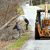 The high wind warning that was in effect Wednesday caused minimal damage or power outages over the area. Here Chesterfield workers clear off debris from a fallen tree on Water Street in Chesterfield after using a back hoe to open the roadway after the high winds brought the tree down blocking the road Wednesday afternoon.