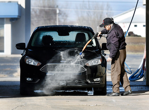 The Wash Tub car wash on Broadway was a busy place Monday as the warm sunshine and above normal temperatures brought out folks to take advantage of the day and get the road grime off their vehicles.