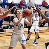 APA's Chelsea Klepfer eyes the basket as Emily Adamowicz and Jasie Johnson of Burris close in to defend.