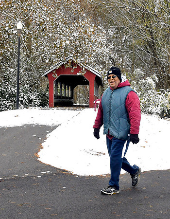 The first snow of the season and bitter cold temperatures didn't stop this walker from getting his laps in around Shadyside Park Tuesday. Cold temperatures will be around for one more day before a gradual warm up builds toward the weekend.