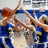 Chelsea Klepfer, of APA, center, tries to split Burris defenders Hannah Kreider and Hannah Houser but looses control of the ball.