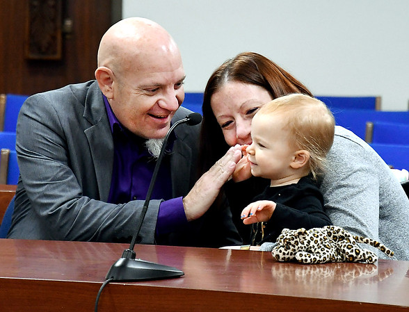 """Zachary Sparks gives a """"high five"""" to his newly adopted daughter Abigail Sparks, 1, as her mother Janelle Sparks watches after their adoption proceeding in Madison County Circuit Court I in front of Judge Angela Sims as part of National Adoption Day Thursday in Madison County."""