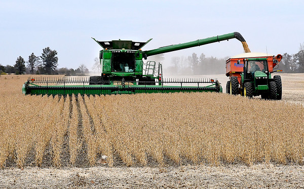 Harvesting of crops continues throughout the county as late planted fields, due to the wet spring, are mature and dry enough for cutting like this farmer harvesting beans near Frankton at county roads 500W & 300N Monday afternoon.