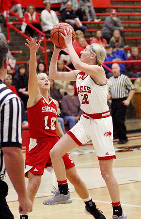 Frankton's Ava Gardner drives to the basket against a Sheridan defender.