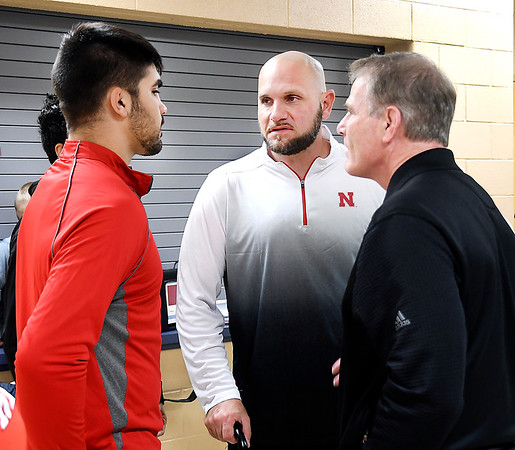 Shenandoah High School state champion wrestler Silas Allred, left, talks with his father, Eric Allred, and University of Nebraska wrestling coach Mark Manning this past Monday before Silas signed his national letter of intent to attend Nebraska next year.