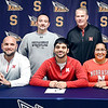 Shenandoah High School's Silas Allred, center seated, signs his national letter of intent to attend the University of Nebraska this past Monday as seated along with him are his parents, Eric Allred and Dana Ellis. Standing are Silas's Shenandoah wrestling coach Jason Barbosa and University of Nebraska wrestling coach Mark Manning.