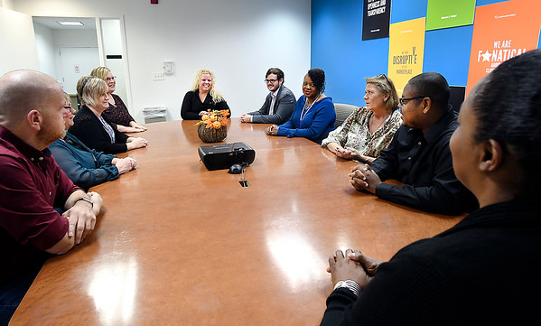 Sharon Bergen, center, site director for the Daleville Concentrix call center, meets with her operations team. The company has announced they are adding 245 full-time and seasonal customer service positions at its Daleville facility.
