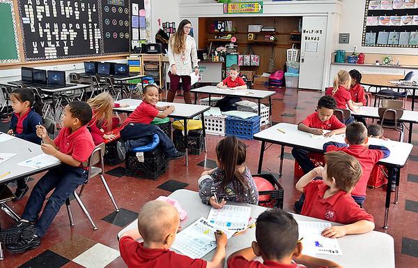 Anderson Preparatory Academy Elementary School kindergarten teacher Julie Reed conducts her class recently.
