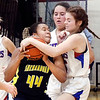 Shenandoah's Erikka Hill fights for the rebound with Elwood's Sydney Scott and Katie Morris.