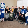 Veteran Brian Sawyer and his family pose for pictures with Colts cheerleaders, Blue, and Colts running back #21 Nyheim Hines after being surprised with all new furniture throughout his house courtesy of the Colts, Bob's Discount Furniture and Operation Homefront.