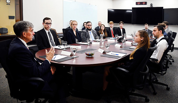 Chris Inglis, former deputy director of the National Security Agency, speaks to a group of national security, cybersecurity and political science students Tuesday in Anderson University's Situation Room.