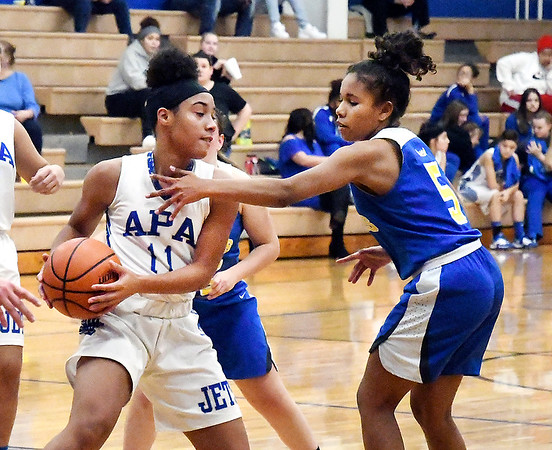 APA's Tommya Davis is closely guarded by Jasie Johnson of Burris as she tries to find a teammate to pass the ball.