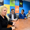 Sharon Bergen, left, site director for the Daleville Concentrix call center, meets with her operations team. The company has announced they are adding 245 full-time and seasonal customer service positions at its Daleville facility.