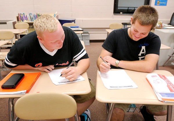 Frankton juniors Andrew Shafer and Gabe Clarkson work together to complete a worksheet during an SAT prep class at Frankton High School on Friday.