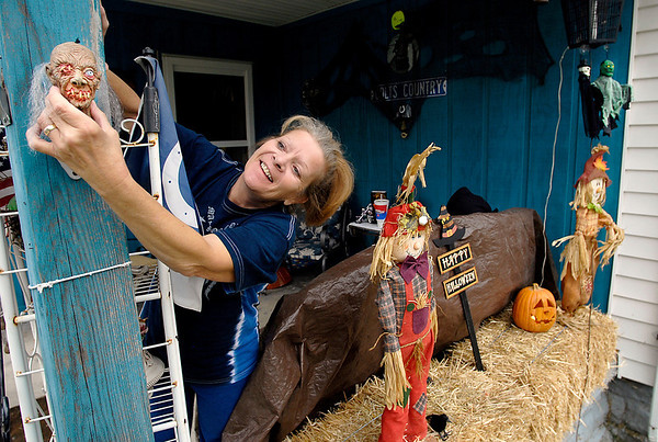 Kathy Davis decorates her front porch at 1612 Walnut Street in Anderson for Halloween Monday afternoon.  Davis says she loves the Halloween  season and always starts decorating for it on October 1st each year.