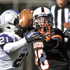 HEAD-TO-HEAD BALL CONTACT!   AU's quarterback Nate Leeper gets hit by Bluffton's Derek Woods as he tries to throw.  The ball came loose but AU recovered the fumble.