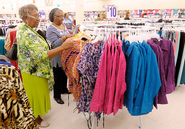 From left, Rosetta Jones and Bertha Jenkins from Muncie shop at Roses in Anderson during the store's grand opening on Thursday.