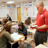 Teacher Brett Sanders answers a question for Gabbie Abrams and Ciara Roberts as they work on a worksheet during an SAT prep class at Frankton on Friday.