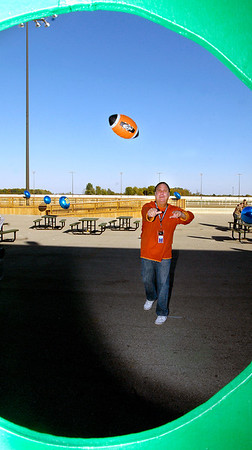 """Hoosier Park held a celebration party for their employees Monday for winning 22 1st place """"Best Of""""  awards from Midwest Gaming & Travel magazine.  Todd Berendji, director of casino operations, gives the football toss a try."""