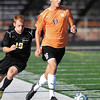 AU's Patrick Freeman gets ahead of Manchester's defender Andrew Gray.