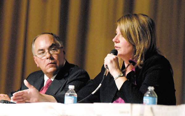 Jack Lutz, R, District 35, listens to his opponent, Melanie Wright, D, District 35, during the State Representative candidate forum Thursday evening.