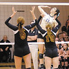 Madison-Grant's Hunter Wise goes on the attack as Alexandria's Allie Hueston (9) and Morgan Oliver (13) prepare to try and block Hueston as the Argylls faced the Tigers in the sectional semi-final on Saturday.