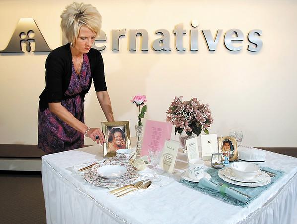 "Kandi Floyd puts the finishing touches on Alternatives  ""empty table settings."""