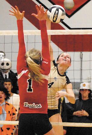 Madison Grant's Balie Havens shoots over Wapahani player Aubreigh Applegate.