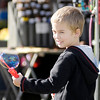 Jake Thompson, 5, of Alexandria creates bubbles during the Small Town USA Festival in Alexandria on Saturday.