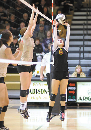 Alexandria's Hannah Libler sets the ball as the Tigers faced the Madison-Grant Argylls in the sectional semi-final on Saturday.