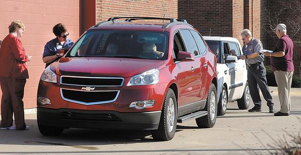 Cars lined up for Saint John's Medical Center  drive-through flu shots Wednesday.