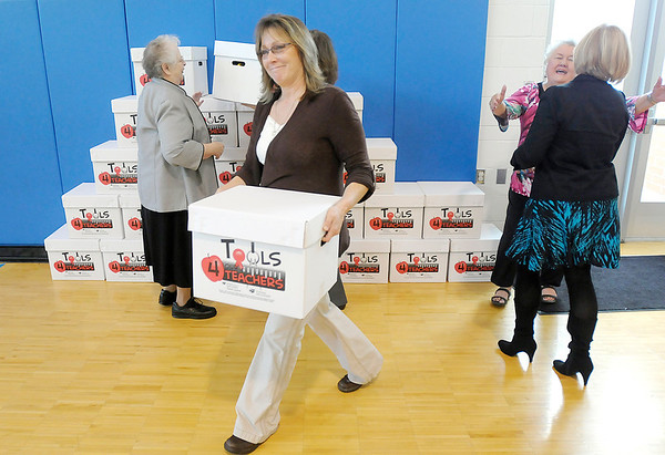"""Teachers at Erskine Elementary pick up their """"Tools 4 Teachers"""" box of supplies on Thursday. Saint John's lead the community effort to give each teacher in the county a box of supplies for their classroom."""