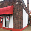 Bricks fell from the chimney of the building at 6th & Meridian Tuesday morning that houses the Madison County Republican Headquarters and closed 6th Street between Jackson and Meridians Streets.