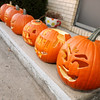 Blake Buck and his girlfriend Shawnae Saylor involved their family in a Halloween jack-o'-lantern carving blitz. A total of 19 pumpkins were carved on Saturday and 15 remain on display on West 53rd Street. Helping with the carving were Braxton Saylor, Brandon Ellingwood, Lance Cox and Daja Nunn.