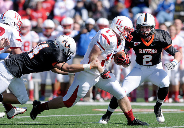 AU's Ben Southards (34) and Tyler Ganus (2) tackle Hanover's Shawn Gibson as the Ravens hosted the Panthers during homecoming on Saturday.