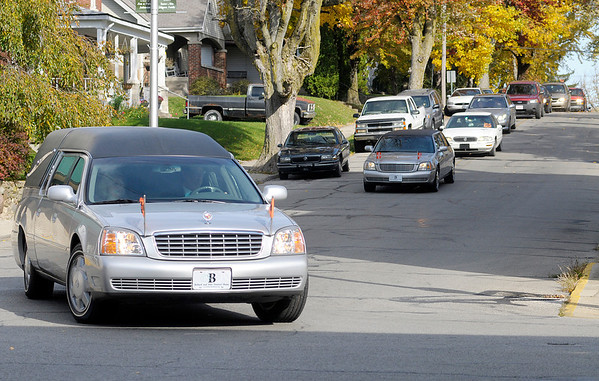 The funeral procession for Ruth Webb travels through Middletown en route to Miller Cemetery on Wednesday. Henry County authorities say Johnny Webb of Anderson, shot Ruth Webb and Robert Morrow at her home on North County Road 200 West before driving to a spot three miles away where he took his own life.