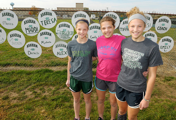 The Dudley sisters, from left, Monica, Teresa and Anna run on the Pendleton Heights cross country team.
