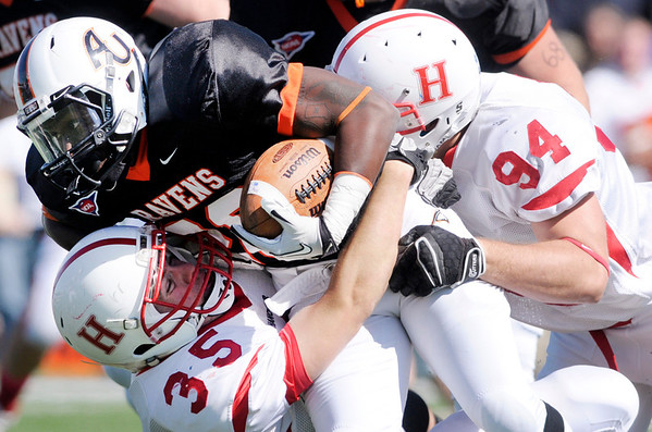 Hanover's Justin Magaw (35) and Tom Call (94) tackle AU running back Torrance McCollum as the Ravens hosted the Panthers during homecoming on Saturday.
