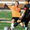 AU's Brad Rusche comes in for a slide kick.