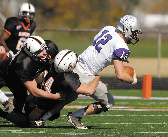 AU's Sean Brooks helps teammate Josh Compton bring down Bluffton's quarterback  Tyler Wright for a loss on the play.